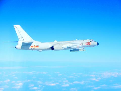 A photo released by Taiwan's defense ministry shows a PLA H-6K bomber above the Taiwan Strait.