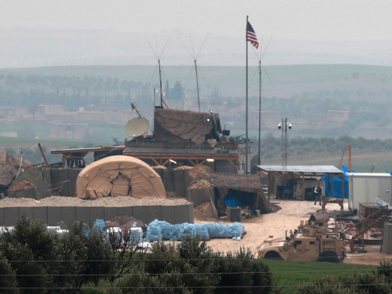 Vehicles and structures of the US-backed forces are seen on the outskirts of Manbij in northern Syria on December 26, 2018. Pro-Turkish armed groups have reinforced their presence on the outskirts of the city as Ankara threatens a new offensive against Kurdish forces. President Trump's announcement that he will pull troops out of the country has left the Kurds exposed to attack. Photo: Delil Souleiman / AFP