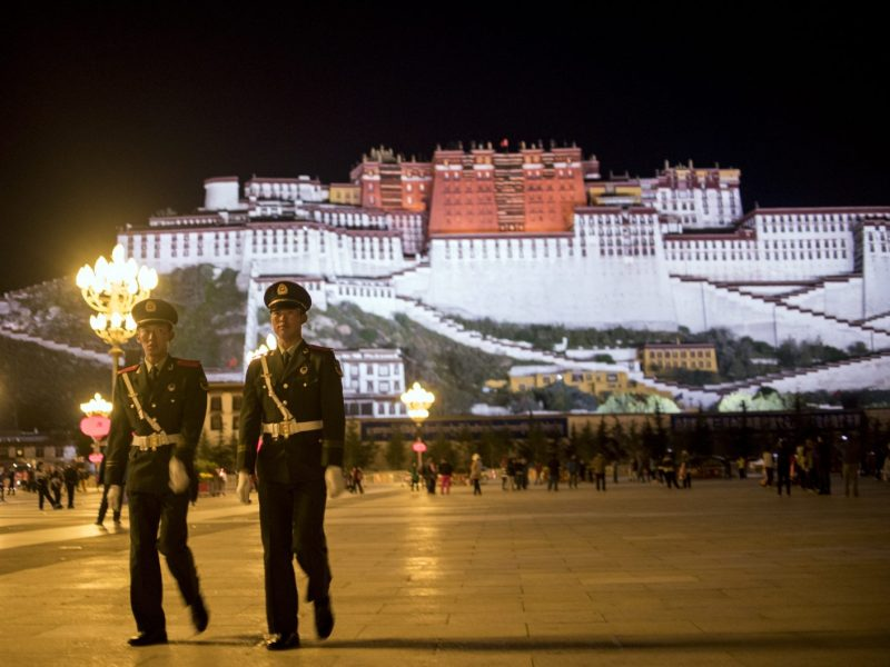 Two Chinese paramilitary policemen patrol near the iconic Potala Palace in Lhasa in China's Tibet Autonomous Region. The US Congress has voted to demand access for US diplomats, journalists and tourists to Tibet. Photo: AFP/Johannes Eisele