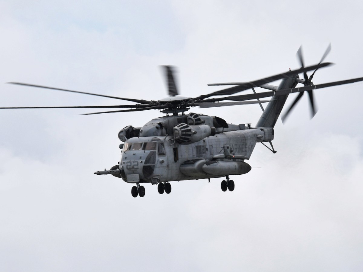 A large transport helicopter for US Marines takes off from Futemnma air station in Okinawa in October 2017. A search is being conducted for six Marines missing after an air crash today off southwestern Japan. Photo: AFP / Yomiuri Shimbun