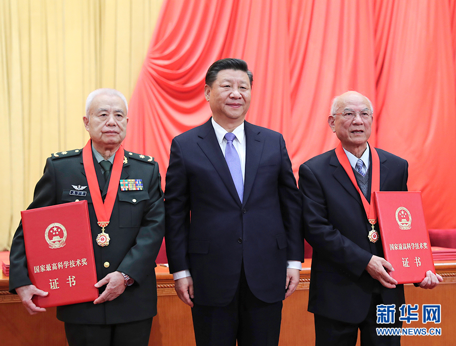 Xi Jinping (center) awards the top  prizes to two PLA scientists. Photo: Xinhua