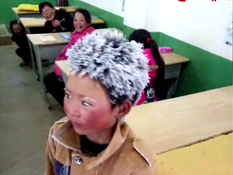 "Wang Fuman, or ""Frosty Boy,"" when he turned up at Zhuanshanbao primary school after a 4.5-kilometer hike. Photo: Online"