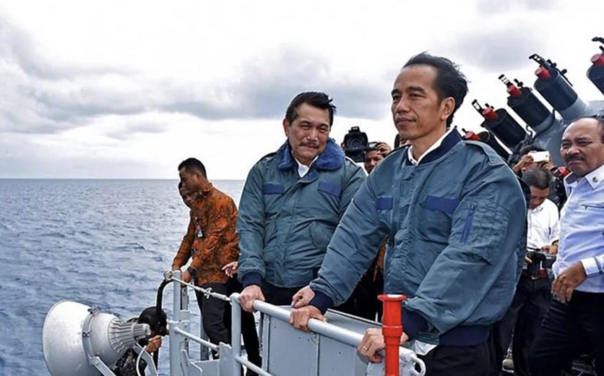 Indonesian President Joko Widodo looks out to sea in a December 2018 government handout photo.