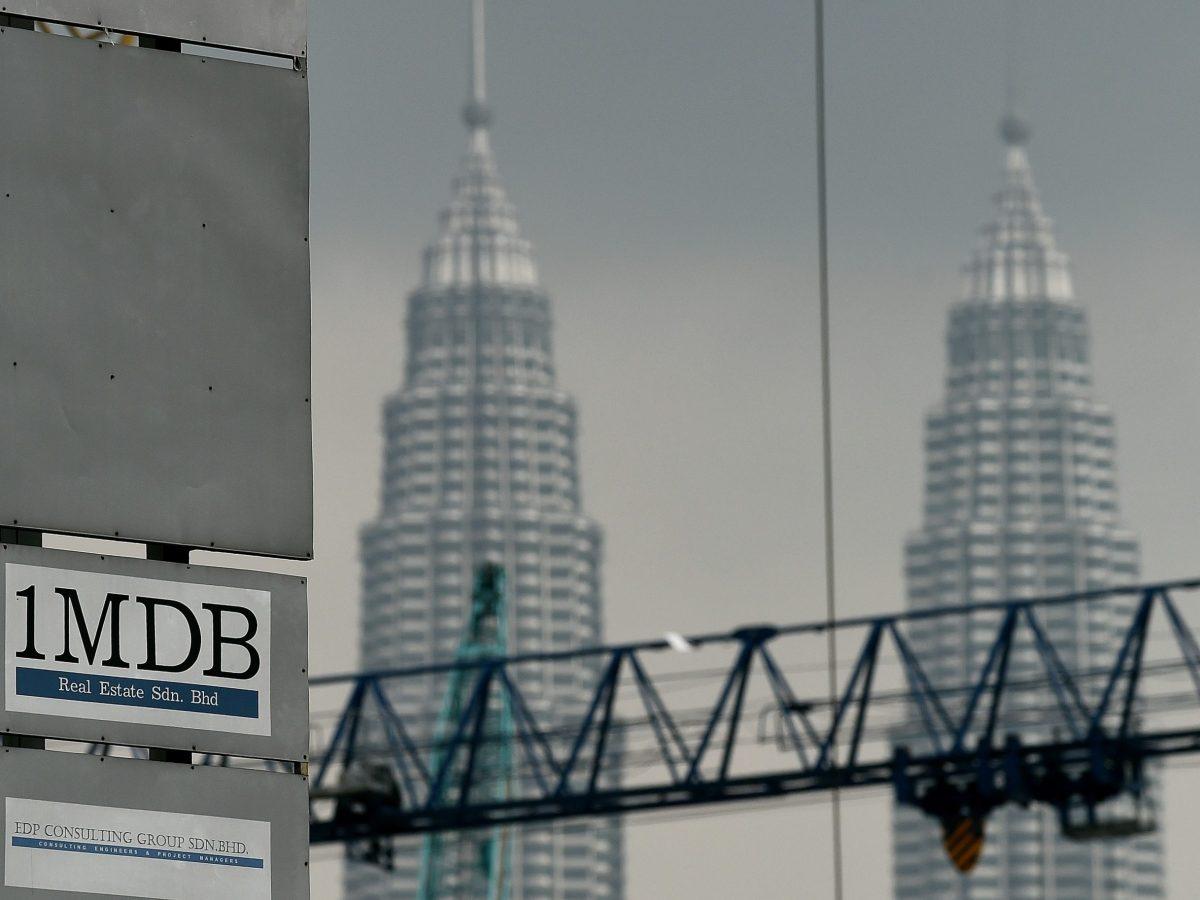 The 1 Malaysia Development Berhad (1MDB) logo is seen on a billboard in Kuala Lumpur. Photo: AFP/Getty Images