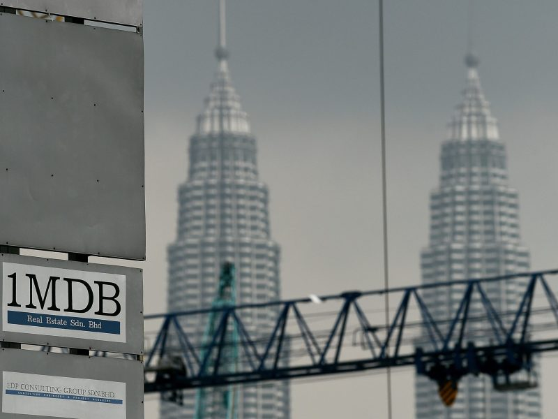 The 1 Malaysia Development Berhad (1MDB) logo is seen on a billboard in Kuala Lumpur. Photo: AFP/Getty Images