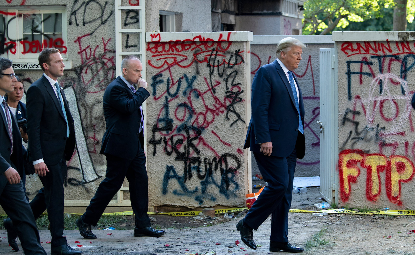 US President Donald Trump walks back to the White House escorted by the Secret Service after appearing outside of St John's Episcopal church across Lafayette Park in Washington, DC, June 1, 2020. Photo: AFP/ Brendan Smialowski