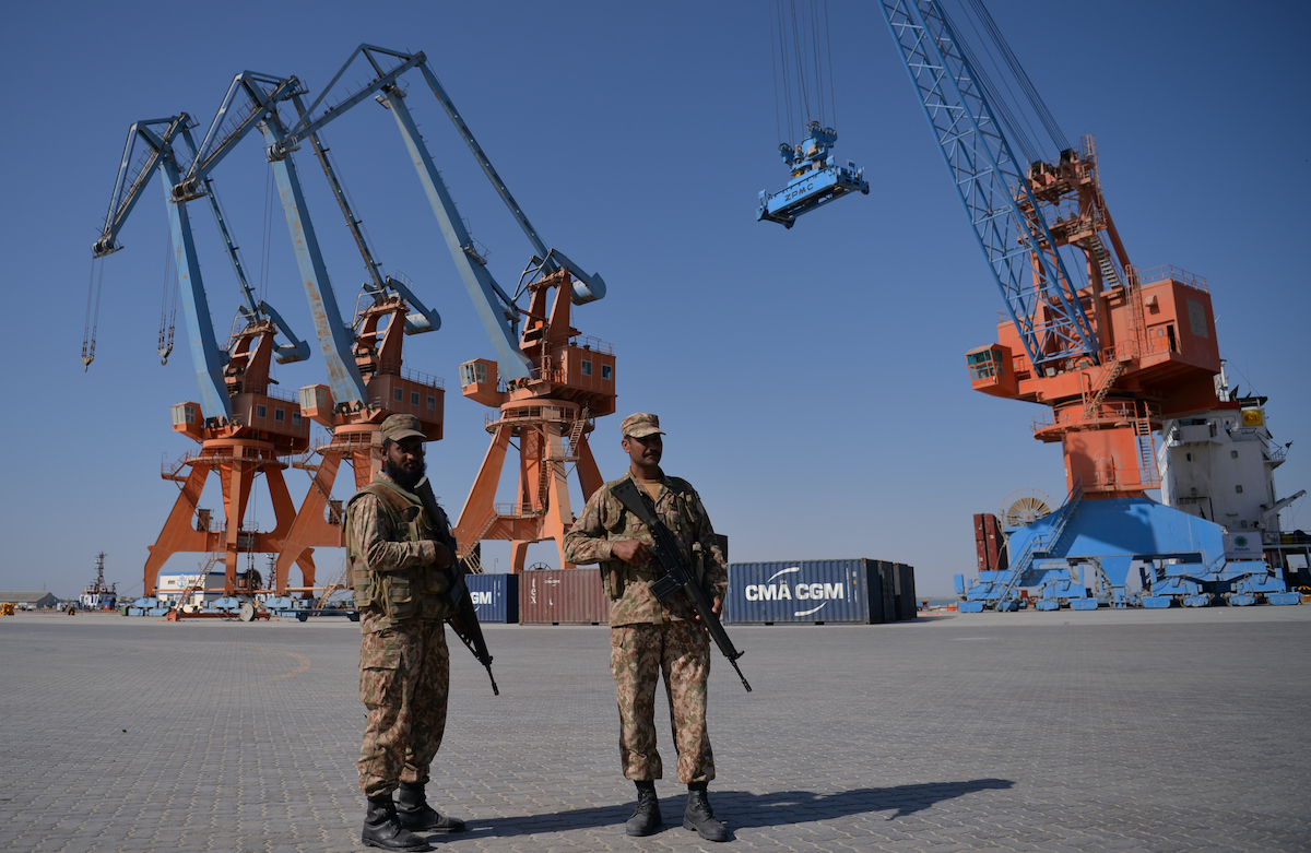 Pakistani naval personnel stand guard near a ship carrying containers at the Gwadar port, 700kms west of Karachi, where a trade program between Pakistan and China operates. Photo: AFP/Aamir Qureshi