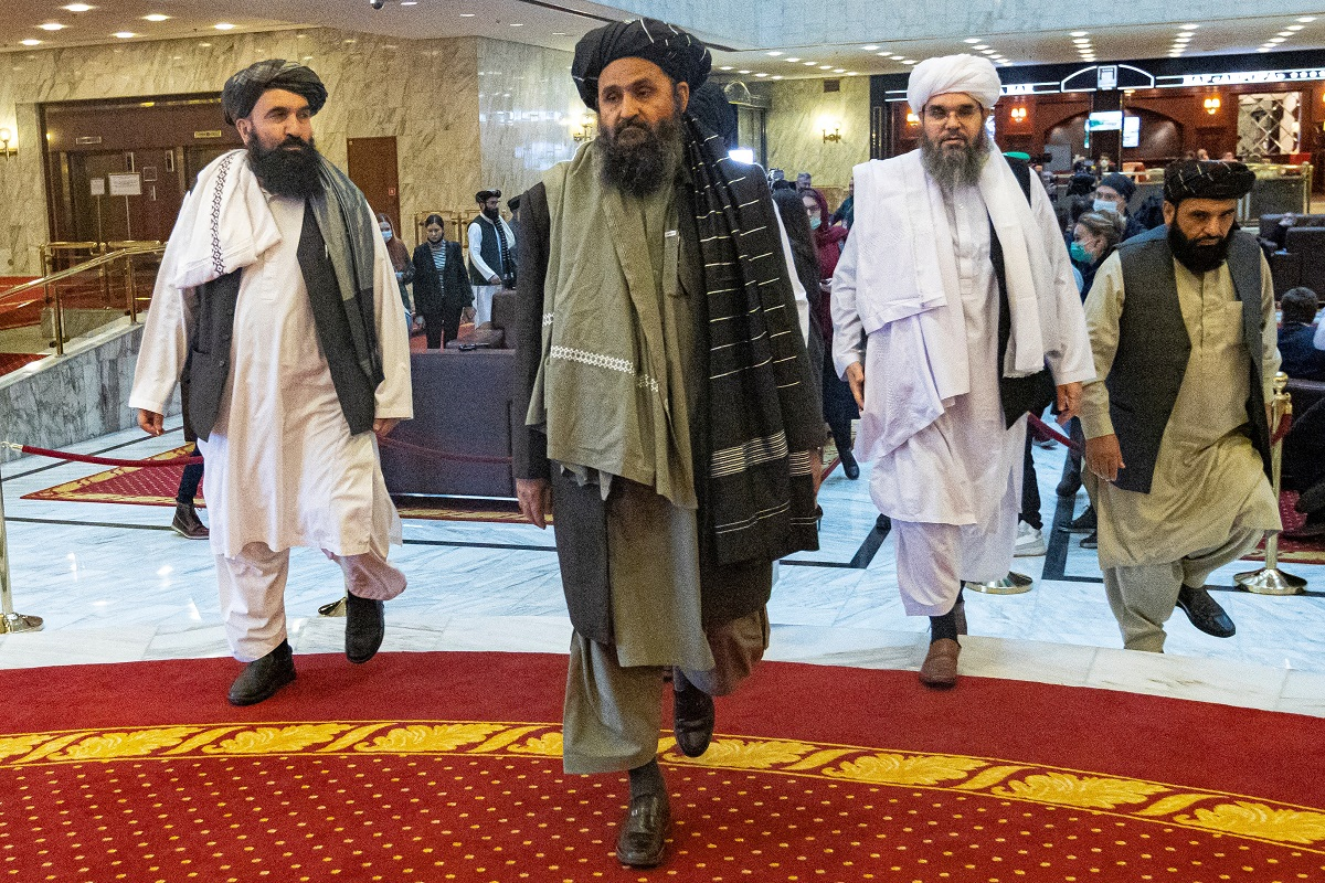 Taliban co-founder Mullah Abdul Ghani Baradar (center) and other members of the Taliban arrive to attend an international conference in Moscow on March 18, 2021. Photo: Alexander Zemlianichenko / AFP