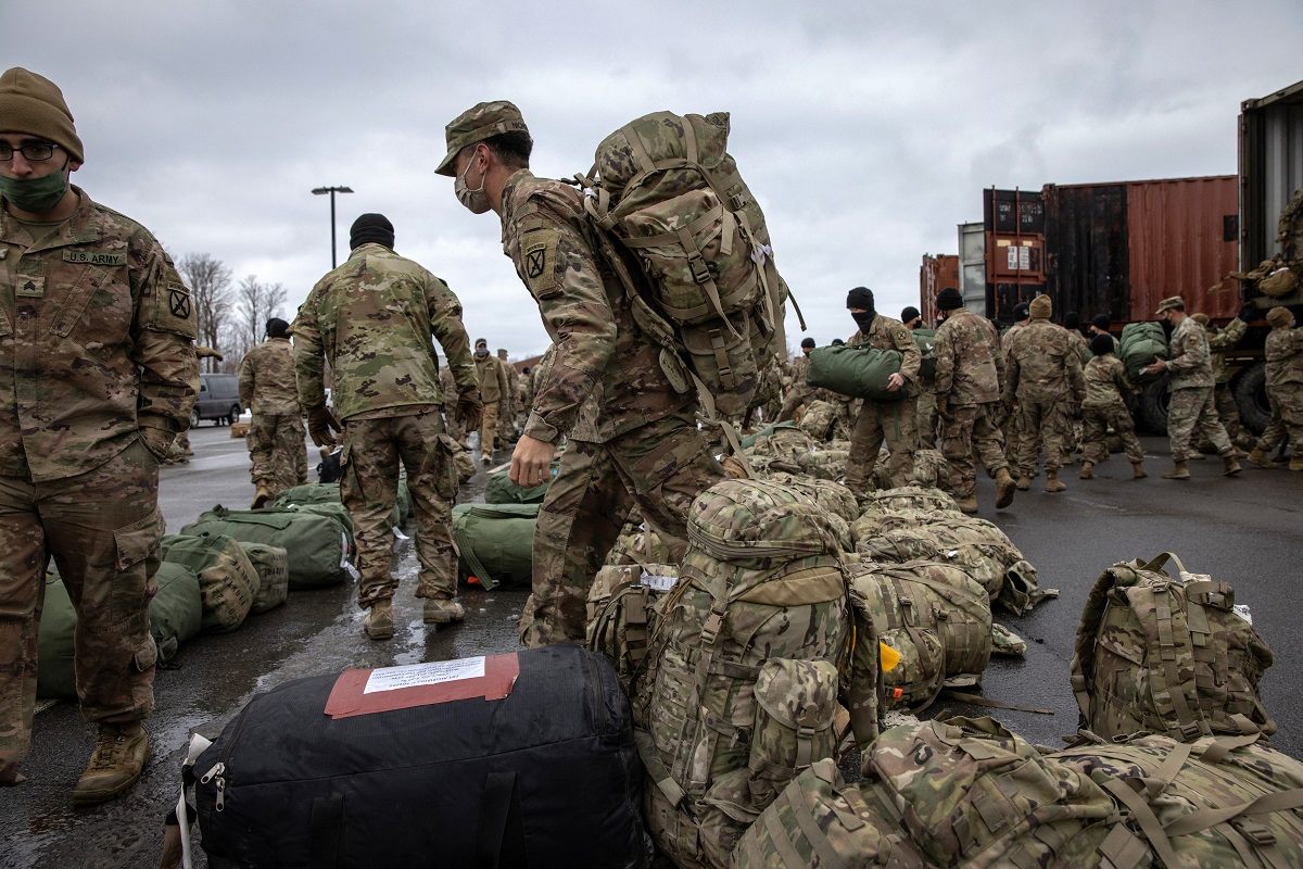 American soldiers retrieve their duffel bags after they returned home from a nine-month deployment to Afghanistan on December 10, 2020, at Fort Drum, New York. Supposedly all US troops are to withdraw from Afghanistan by September 11, 2021. Photo: AFP / John Moore / Getty Images