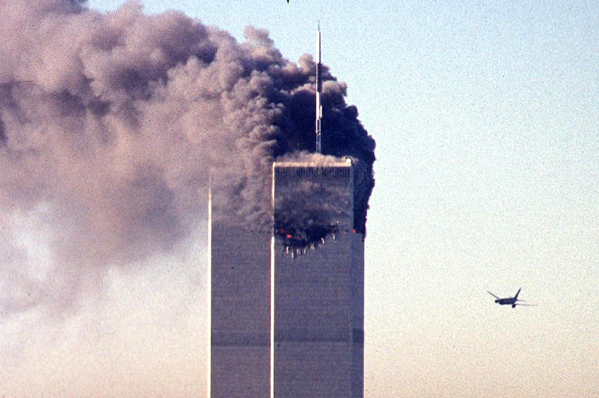 In this file photo taken on September 11, 2001, a hijacked commercial aircraft approaches the twin towers of the World Trade Center shortly before crashing into the landmark skyscraper in New York. Photo: AFP / Seth McAllister