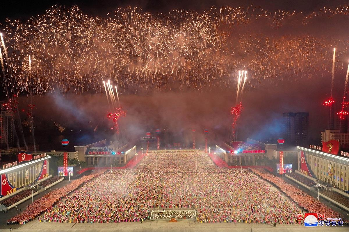 Kim parades at midnight but China muffles his guns