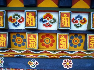 Best Places To Visit In Thimphu Bhutan - Clock Tower Square, Close Up of Traditional Bhutanese Prayer Wheel Art