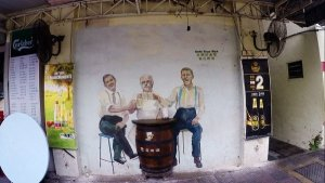 Things To Do In Ipoh - Mural Art of three men toasting with beer