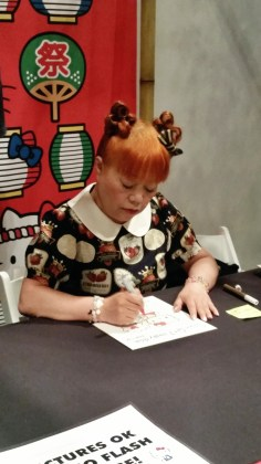 Yuko Yamaguchi, the head designer of Hello Kitty, giving out personalized autographs to fans