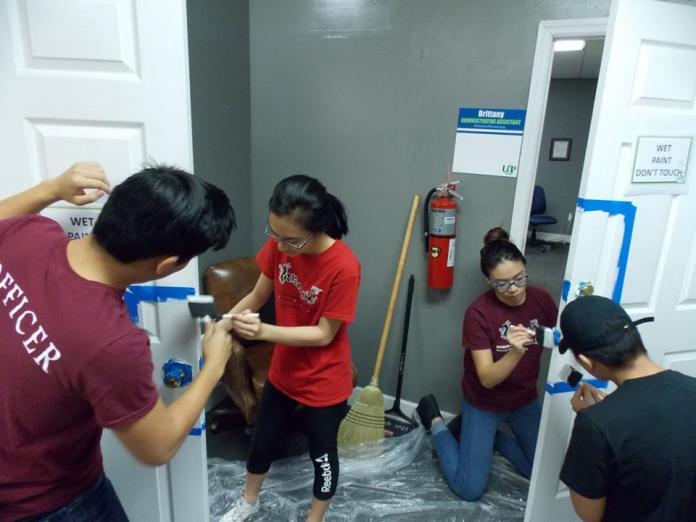 Volunteers Repainting UAP