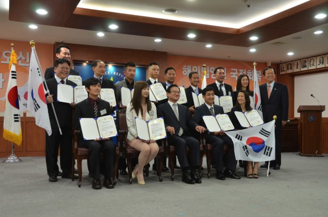 First 13 Korean adoptees receiving Dual Citizenship in Korea pose for a photo. Dual citizenship in Korea for adoptees was made possible through lobbying efforts led by adoptee activists in Korea. (Photo courtesy of G.O.A.'L.)