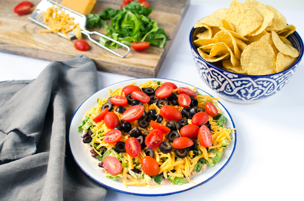 Making Mexican recipes tonight! Easy and delicious layered taco dip!