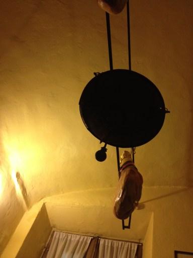 Prosciutto crudo- dry hams hung from restaurant ceiling