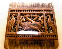 An ivory comb with hansa puttu motif.