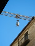 ... taken up by crane and rotated away out of sight over the rooftops to a work site.