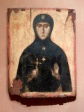 This saint was my favorite of the collection. Her austere clothing and dour expression hint at a dark end in martyrdom.