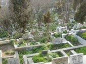 The graveyard is steeply sloped so each grave or set of a few graves has its own marble retaining wall.