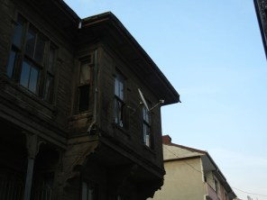 The slightly projecting second floor balcony is a common typology.