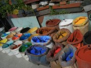 I loved the contrast of these bags of pigment on the sidewalk here and two doors down a store of modern paint in five gallon buckets. Tools for any type of painter.