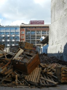I love the contrast of fancy station area hotel and random pile of scrap for sale as firewood