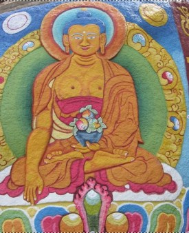 Photo: Tibetan painting of Shakymuni Buddha on a boulder at the Palpung Monastery, onwardtibet.org
