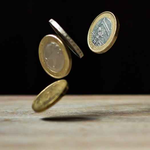 Coins dropping on to a table