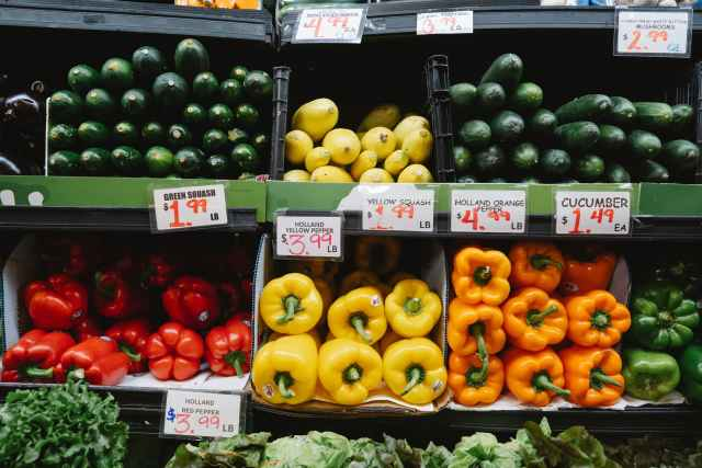 a view at vegetables on shelves in a grocery store