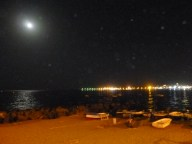 A lovely moonlit night by the beach of Giardini-Naxos, with the little fishing boats on the beach