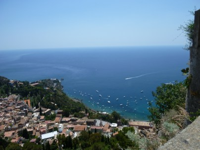 Bird's eye view of Taormina below and beyond the Ionian sea