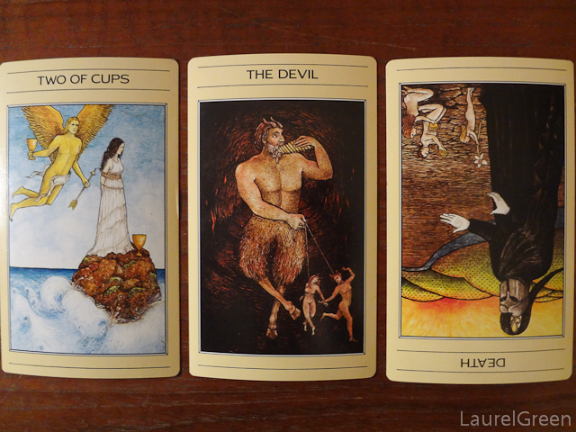 a three card tarot spread with the two of cups, the devil and death reversed