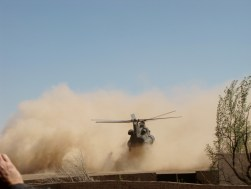 In a cloud of pink dust, a Chinook helicopter comes in for a landing at Playas, New Mexico