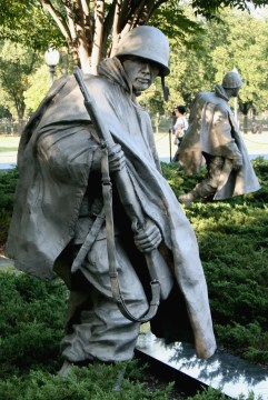 Close-up of a statue of a soldier looking back over his shoulder at the Korean War Memorial in Washington, DC.