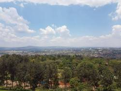 Photo of a calm, african skyline with a pan view of a quiet city below