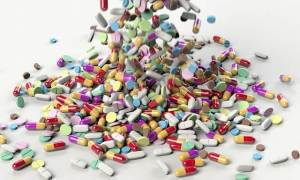 A pile of different coloured pills and tablets - denoting antibiotic resistance when the medicines are abused and used incorrectly.