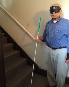 Image of Doug Moody standing next to the stairs at BLIND, Inc.
