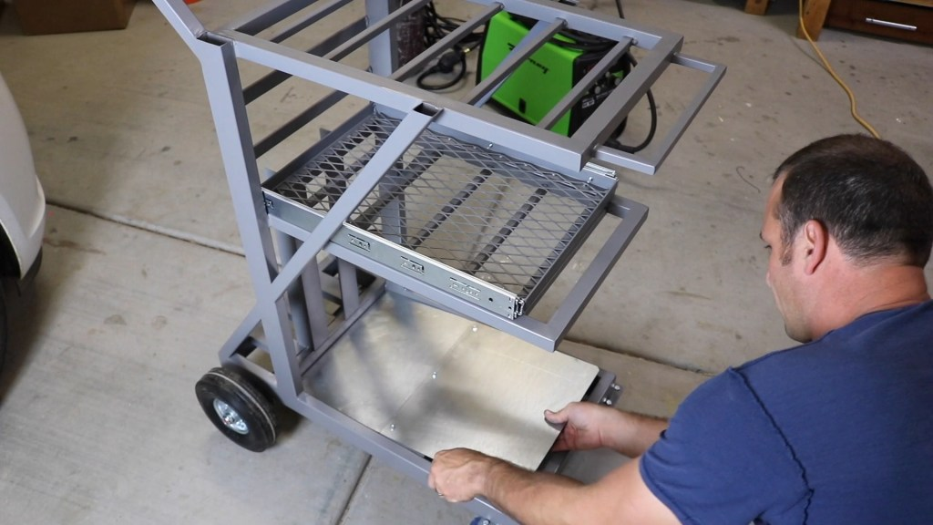 add sheet metal to the bottom shelf of the cart to refine the look