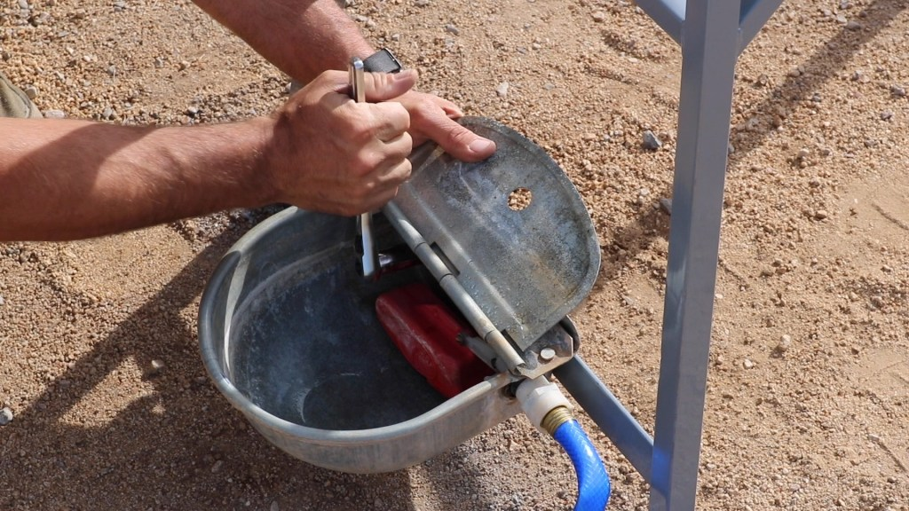 attach the galvanized float bowl and hose