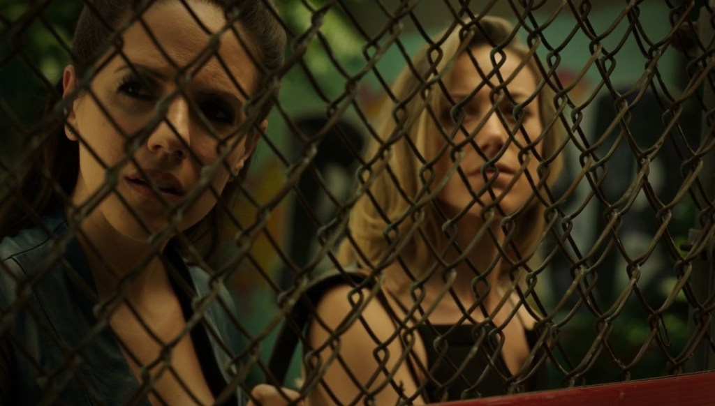 Bo and Lauren behind fence in Lost Girl 4x05