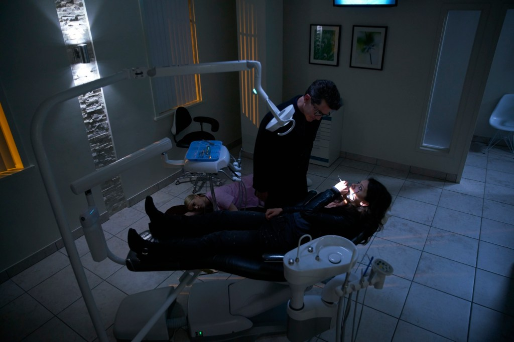 Sarah in dentists chair with Ferdinand in The Stigmata of Progress