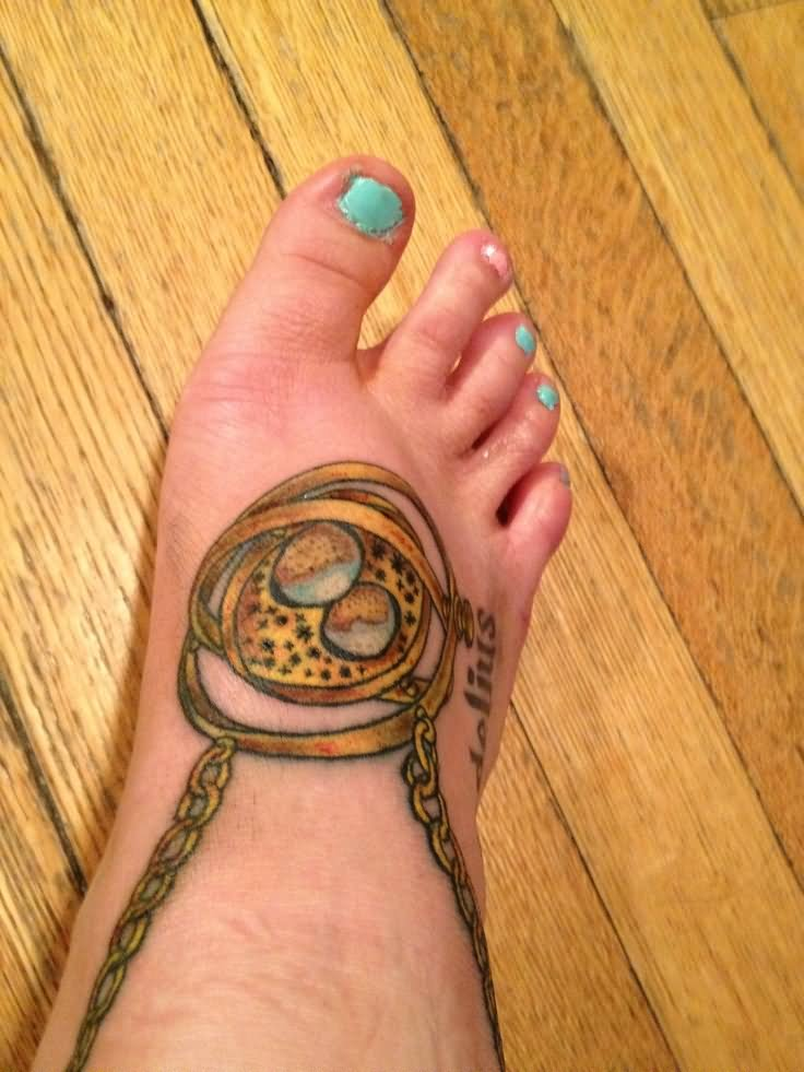 Cool Time Turner Tattoo On Girl Right Foot By Jake Del Bene