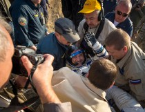 Expedition 36 Commander Pavel Vinogradov of the Russian Federal Space Agency (Roscosmos) is helped out of the Soyuz TMA-08M capsule after he and, Flight Engineer Alexander Misurkin of Roscosmos and Flight Engineer Chris Cassidy of NASA landed in a Soyuz TMA-08M spacecraft in a remote area near the town of Zhezkazgan, Kazakhstan, on Wednesday, Sept. 11, 2013. Vinogradov, Misurkin and Cassidy returned to Earth after five and a half months on the International Space Station. Photo Credit: (NASA/Bill Ingalls)