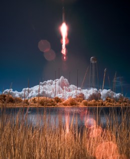 The Orbital Sciences Corporation Antares rocket, with the Cygnus cargo spacecraft aboard, is seen in this false color infrared image, as it launches from Pad-0A of the Mid-Atlantic Regional Spaceport (MARS), Wednesday, Sept. 18, 2013, NASA Wallops Flight Facility, Virginia. Cygnus is on its way to rendezvous with the space station. The spacecraft will deliver about 1,300 pounds (589 kilograms) of cargo, including food and clothing, to the Expedition 37 crew. Photo Credit: (NASA/Bill Ingalls) **THIS IMAGE IS A FALSE COLOR INFRARED IMAGE MADE FROM A MODIFIED DIGITAL SLR CAMERA**