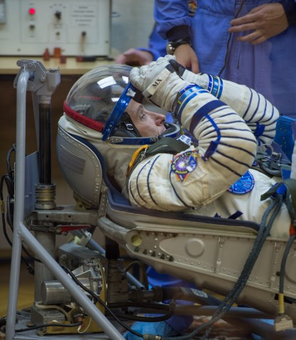 Expedition 37/38 NASA Engineer Michael Hopkins has his Russian Sokol suit pressure checked ahead of his launch onboard a Soyuz TMA-10M spacecraft to the International Space Station with fellow crewmates Russian Flight Engineer Sergey Ryazanskiy and Soyuz Commander Oleg Kotov, on Wednesday, Sept. 25, 2013, in Baikonur, Kazakhstan. Launch of the Soyuz rocket will send the Expedition 37/38 crewmates on a five-month mission aboard the International Space Station. Photo Credit: (NASA/Carla Cioffi)