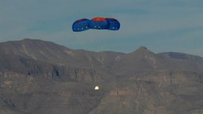 The New Shepard Crew Capsule escaped to an altitude of 2,307 feet before deploying parachutes for a safe return Image via Blueorigin.com
