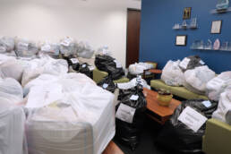 Photo of bags and boxes of blankets in office area